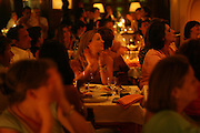 """The audience at """"Faia"""". This restaurant  is one of most famous houses were to see live perfomances of Fado music and it attracts many tourists. It was founded in 1947 by Lucilia do Carmo, one of the legendary woman Fado singers."""