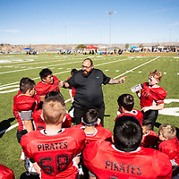 Coach of the Grants Pirates Chris Archuleta discusses strategy during halftime of their game against Cleveland Storm East, Saturday Oct. 27, 2018 at the Tony Dorsett Touch Down Football League (TDFL) Four Corners Football Tournament in Gallup.