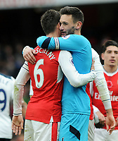 Football - 2016 / 2017 Premier League - Arsenal vs. Tottenham Hotspur<br /> <br /> Hugo Lloris and Laurent Koscielny ( French team mates ) embrace after the match at The Emirates.<br /> <br /> COLORSPORT/ANDREW COWIE