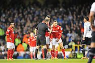 Cardiff's Craig Bellamy is  given a warning by Referee Phil Dowd .Barclays Premier League , Tottenham Hotspur v Cardiff city at White Hart Lane in London, England on Sunday 2nd March 2014.<br /> pic by John Fletcher, Andrew Orchard sports photography.
