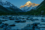 Oceania, New Zealand, Aotearoa, South Island, Mount Cook National Park, Mount Cook in Hooker Valley at sunset