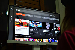 February 6, 2018 - Ankara, Turkey - A woman looks at videos to watch on video-sharing website Youtube in Ankara, Turkey on February 5, 2018 as an omnibus bill introduced to the parliament, allows the Radio and Television Supreme Council (RTUK) to monitor and censor online streaming services, including Netflix, Spotify and Youtube. (Credit Image: © Altan Gocher/NurPhoto via ZUMA Press)