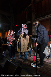 Rebecca and Chris Canterbury of Boxer Metal on stage after getting the BMW award from Roland Stocker of BMW for their 1980 BMW R100 rigid frame twin turbo with One Show organizer Thor Drake also on stage during the motorcycle show in Portland, OR. February 13, 2016. ©2016 Michael Lichter