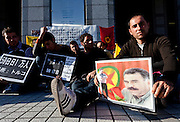 Kurdish hunger strikers hold a placard with a photo of Kurdish political leader Abdullah Ocalan on it outside the United Nations University in Omote Sando, Tokyo, Japan. Friday November 9th 2012. The strike lasted from 8am to 8pm to show solidarity with nearly 800 Kurdish political prisoners held in Turkey who have been on hunger strike for 2 months