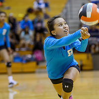 Navajo Prep Eagle Taina Sandoval (8) lunges under a shot from the Gallup Bengals Wednesday at Gallup High School.