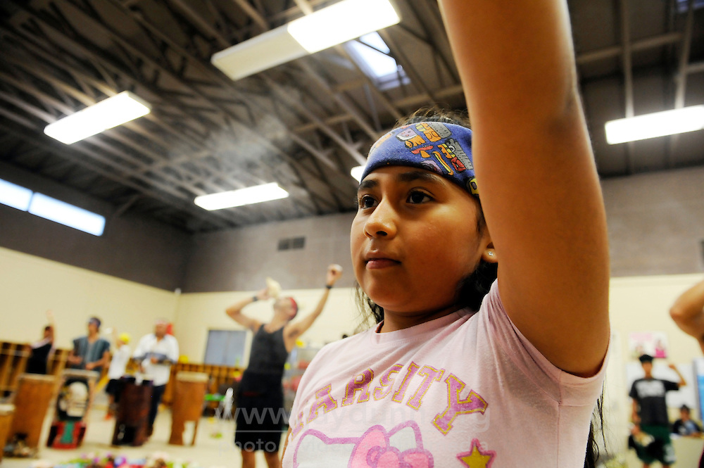 Children learn the traditions of their ancestors during Yaocuauhtli - Eagle Warrior's weekly dances on Thursday evenings in El Dorado Park in Salinas. These gatherings, which are both instructional and devotional, are open to all, and can last many hours.