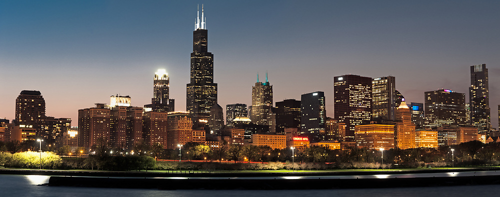 The lakeshore and Willis (Sears) Tower are seen at last light from near the Adler Planetarium.