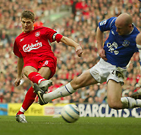 Photo Aidan Ellis.<br /> Liverpool v Everton.<br /> FA Barclays Premiership.<br /> 20/03/2005.<br /> Liverpool's Steven Gerrard scores the first goal as Everton's Lee Carsley attempts to block it