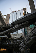A partialy destroyed building in Shejaiya, some family tried to replace the missing walls of their appartments with blankets