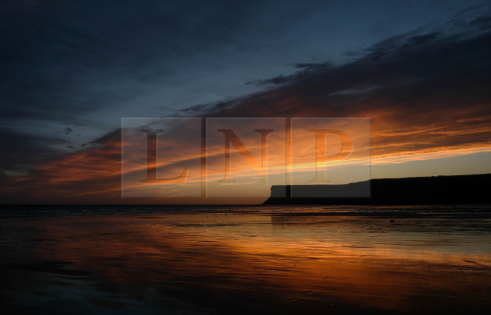 © Licensed to London News Pictures. <br /> 29/09/2016. <br /> Saltburn-by-the-Sea, UK.  <br /> <br /> A dramatic dawn sky can is seen over the cliffs at Saltburn by the Sea.<br /> <br /> Photo credit: Ian Forsyth/LNP