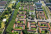Nederland, Noord-Holland, Amsterdam, 14-06-2012; Woonbuurt in Slotervaart, eengezinswoningen gebouwd volgens ruim opgezet stratenplan. Burgemeester Rendorpstraat (vlnr), links de Burgemeester Van Tienhovengracht, rechts Burgemeester Roellstraat . De doopsgezinde kerk De Olijftak is nu in gebruik als Moskee El Hijra (Marokkaans). De moordenaar Mohammed Bouyeri van Theo van Gogh woonde in deze buurt...De wijk is onderdeel van de Westelijke Tuinsteden, gerealiseerd op basis van het Algemeen Uitbreidingsplan voor Amsterdam (AUP, 1935). Voorbeeld van het Nieuwe Bouwen, open bebouwing in stroken, langwerpige bouwblokken afgewisseld met groenstroken. .Residential district Slotervaart, one of the western garden cities of Amsterdam-west..  Constructed on the basis of the General Extension Plan for Amsterdam (AUP, 1935). Example of the New Building (het Nieuwe Bouwen), detached in strips, oblong housing blocks alternated with green areas, built in fifties and sixties of the 20th century. Church is now a mosque...luchtfoto (toeslag), aerial photo (additional fee required).foto/photo Siebe Swart