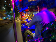 22 OCTOBER 2014 - BANGKOK, THAILAND:   A tuk-tuk, or three wheeled taxi, on Yaowarat Road in Bangkok.     PHOTO BY JACK KURTZ