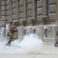 People in period military uniforms re-enact the Warsaw Uprising on the 74th anniversary in Budapest, Hungary on Aug. 1, 2018. ATTILA VOLGYI