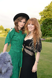 Left to right, TALI LENNOX and CHARLOTTE TILBURY at the Fashion Rules Exhibition Opening at Kensington Palace, London W8 on 4th July 2013.