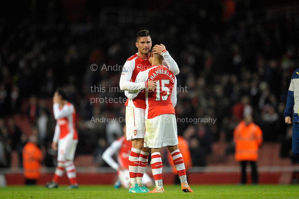 Olivier Giroud of Arsenal consoles Alex Oxlade-Chamberlain of Arsenal after the final whistle. Barclays Premier league match, Arsenal v Manchester Utd at the Emirates Stadium in London on Saturday 22nd November 2014.<br /> pic by John Patrick Fletcher, Andrew Orchard sports photography.
