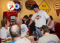Bonnie and Ron Carbary of Meredith speak with Republican Presidential Candidate Scott Walker during a stop at Route 104 Diner in New Hampton from Walker's Harley Tour.  (Karen Bobotas/for the Laconia Daily Sun)