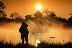 © Licensed to London News Pictures. 07/04/2021. London, UK. The sun rises over a misty pond in freezing conditions in Bushy Park, south west London. Below zero temperatures overnight have brought frost to some parts of the south. Photo credit: Peter Macdiarmid/LNP