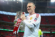 Wayne Rooney of Manchester United with the FA Cup during the The FA Cup Final between Crystal Palace and Manchester United at Wembley Stadium, London, England on 21 May 2016. Photo by Phil Duncan.