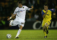 Photo: Rich Eaton.<br /> <br /> Torquay United v Norwich City. Carling Cup. 23/08/2006. Michael Spillane left of Norwich City attacks chased by Lee Mansell of Torquay