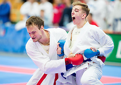 Sebastian Budihna (red) of Slovenia fighting against Team of Hungary (blue) during of Kumite Team male at Day Two of Karate 1 World Cup - Thermana Slovenia Lasko 2014 tournament, on March 16, 2014 in Arena Tri Lilije, Lasko, Slovenia.Photo by Vid Ponikvar / Sportida