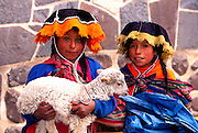PERU, HIGHLANDS, MARKETS Pisac; Quechua children with lamb