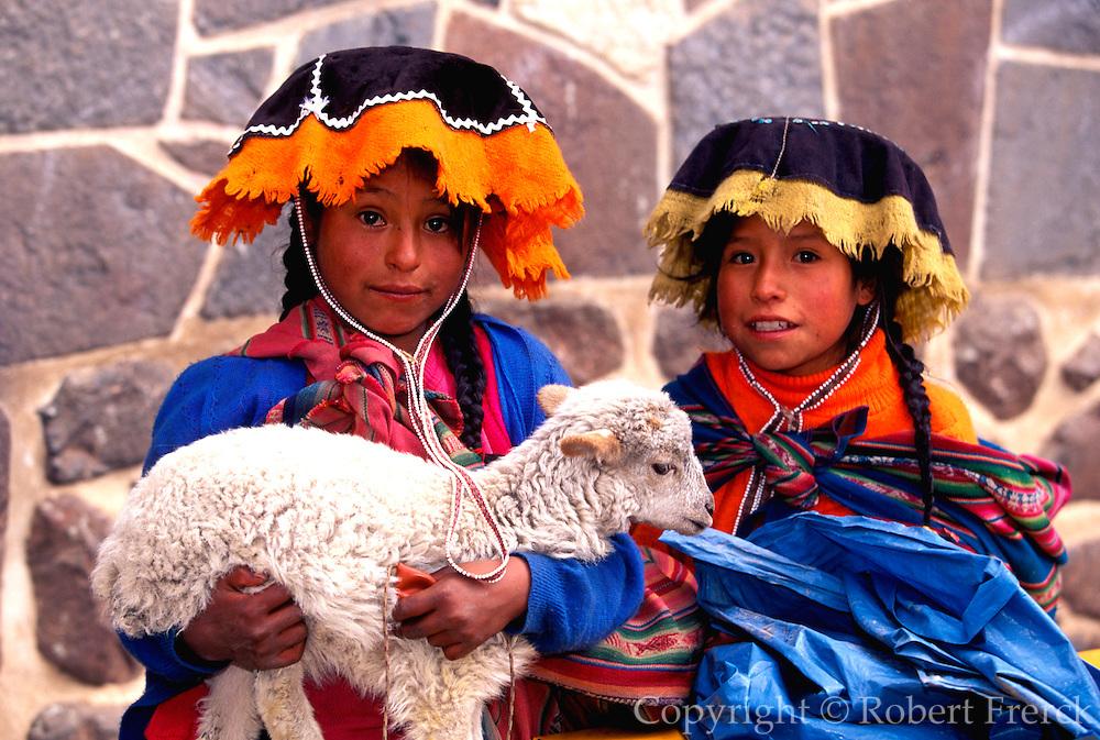 PERU, HIGHLANDS, MARKETS Pisac; Quechua children with lamb