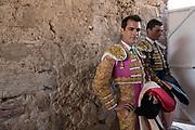 Mexican Matador Arturo Macias, left, and fellow bullfighter Paco Urena wait to enter the ring at the Plaza de Toros in San Miguel de Allende, Mexico.