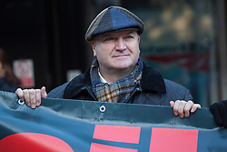 © Licensed to London News Pictures. 11/03/14 RMT union has confined its leader BOB CROW has died today. FILE PICTURE DATED: 11/12/2012. Rail union members Joined by General Secretary of the RMT Bob Crowe demonstrate Outside Euston Railway Station in London over  escalating fare rises. There were protests at Euston, King's Cross, Paddington and Eltham, as research was released showing that average rail fares have risen nearly three times faster than wages since the recession began. Photo credit: Tolga Akmen/LNP