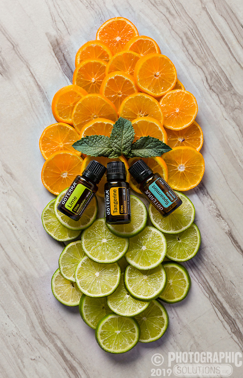 Oranges and Limes in a nice stacked shape, topped with essential oils.