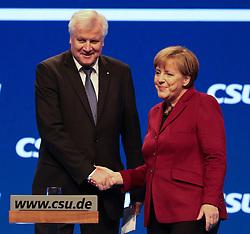 """20.11.2015, Messe Muenchen, Muenchen, GER, CSU Parteitag 2015, Festakt """"70 Jahre CSU"""", im Bild Bundeskanzlerin Dr. Angela Merkel, Haendedruck mit Ministerpraesident Horst Seehofer, // during ceremony """"70 years CSU"""" of CSU party convention in 2015 at the Messe Muenchen in Muenchen, Germany on 2015/11/20. EXPA Pictures © 2015, PhotoCredit: EXPA/ Eibner-Pressefoto/ Krieger<br /> <br /> *****ATTENTION - OUT of GER*****"""