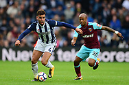 Hal Robson-Kanu of West Bromwich Albion battles for the ball with Andre Ayew of West Ham United. Premier league match, West Bromwich Albion v West Ham United at the Hawthorns stadium in West Bromwich, Midlands on Saturday 16th September 2017. pic by Bradley Collyer, Andrew Orchard sports photography.