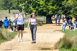 Licensed to London News Pictures. 30/05/2021. London, UK. Members of the public head out in the warm sunshine for a Sunday walk in Richmond Park, southwest London this afternoon. The Met Office have forecast warm weather and sunshine for the South East and London over the Bank Holiday weekend with temperatures predicted to hit up to 24c for Bank Holiday Monday. Photo credit: Alex Lentati/LNP