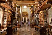 Interior of Austrian National Library - old baroque library of Hapsburg empire located in Hofburg Palace.