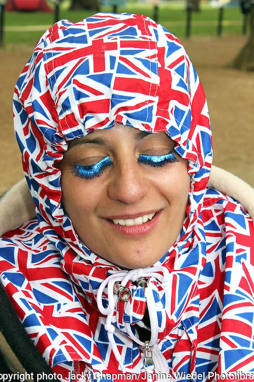 Woman with Union Jack head scarf and false eyelashes at Jubilee Celebrations in London 2012