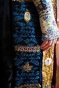 Sandra is wearing a traditional bridal costume in Lüdersfeld, Germany on November 27, 2017.<br /> <br /> This color blue in this particular costume describes that the bride was mourning the death of a close family member. This costume is called a 'Österten Tracht' as part of the Schaumburg Lippe area.<br /> <br /> ***Braut der Österten Tracht aus Lüdersfeld (Schaumburg-Lippe) mit blauem Brüstchen, Kranzdeckel, und Krallenband, da in der Familie ein Trauerfall zu beklagen war.***