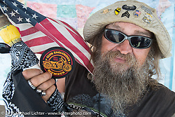 Donald Moondog Fenton, winner of a full year of motorcycle rentals in the Eagle Rider sweepstakes at the Buffalo Chip on the final Saturday of the annual Sturgis Black Hills Motorcycle Rally. SD, USA. August 13, 2016. Photography ©2016 Michael Lichter.