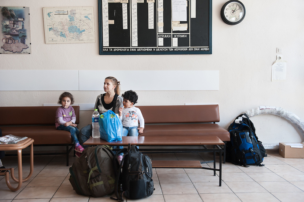 Afternoon of Sunday 13 September 2015. Aysha and her two daughters Sham (L) and Bisan (R) waiting at the regional bus station of Polykastro in Kilkis to board a bus that will take them to their final destination in Greece, the village of Idomeni by the border. The station master told me that since the refugees and migrants started using the Balkan route their bus company which was at the brink of bankruptcy became profitable again.