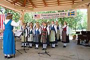 Diane Noble Directs Svenskarnas Dag Girls Choir. Svenskarnas Dag Swedish Heritage Day Minnehaha Park Minneapolis Minnesota USA