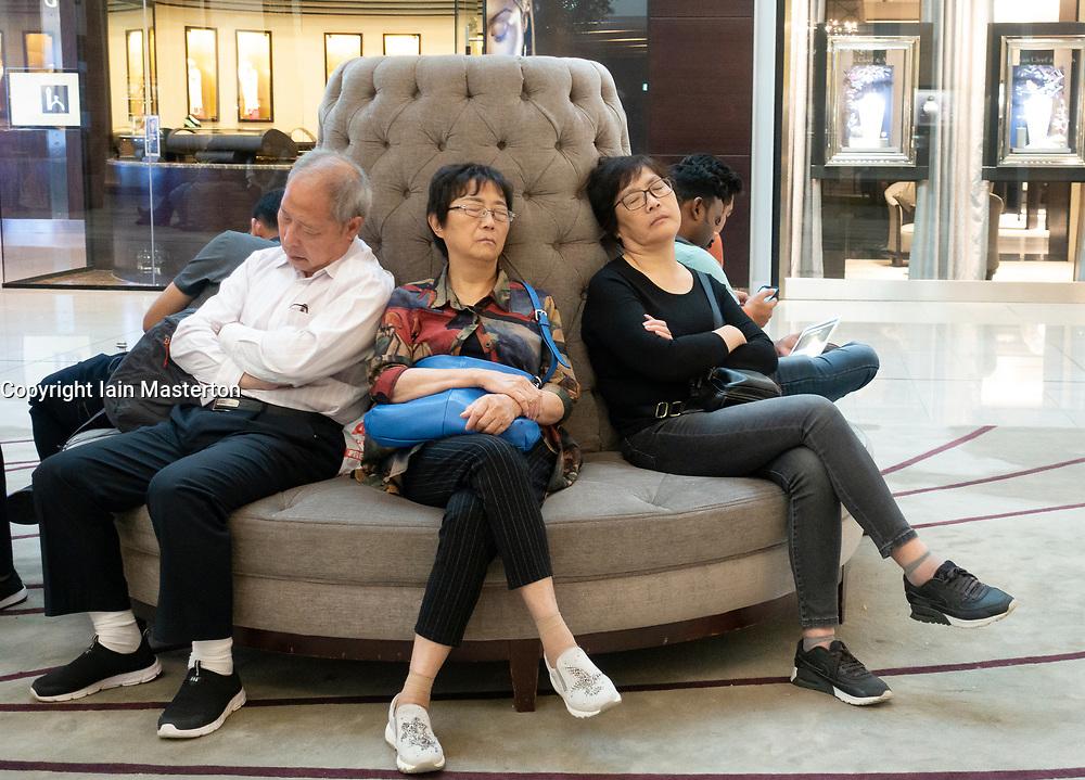 Chinese tourists sleeping inside the Dubai Mall, Dubai, United Arab Emirates, UAE