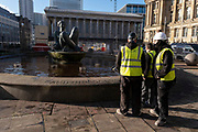Workmen clean the fountain base after being instructed by Birmingham City Council to see if the landmark, known locally as 'The Floozie in the Jacuzzi' in Victoria Square, can be made structurally sound and able to pump water again on 26th November 2020 in Birmingham, United Kingdom. The River, affectionately known as the Floozie in the Jacuzzi, is an artwork by Dhruva Mistry, which following leaks costing two thousands pounds per day, the water was turned off in 2013 to save costs. As of 6 July 2015, the main pool was filled with soil and bedding plants and no longer functioned as a fountain.