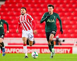 Dele Alli of Tottenham Hotspur surges forward, pursued by Jordan Cousins of Stoke City  - Mandatory by-line: Nick Browning/JMP - 23/12/2020 - FOOTBALL - Bet365 Stadium - Stoke-on-Trent, England - Stoke City v Tottenham Hotspur - Carabao Cup
