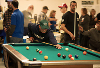 Tim Lahey lines up a shot during the 12th annual Robbie Mills 8-Ball Tournament at the Laconia Rod and Gun on Saturday.  (Karen Bobotas/for the Laconia Daily Sun)