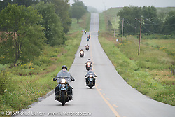 Matt McManus riding his 1936 Harley-Davidson Knucklehead leads a group of bikes through some dismal weather during Stage 7 of the Motorcycle Cannonball Cross-Country Endurance Run, which on this day ran from Sedalia, MO to Junction City, KS., USA. Thursday, September 11, 2014.  Photography ©2014 Michael Lichter.