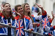 "London, 10th September 2012. Women athletes wave to spectators the day after the end of the London 2012 Paralympics as thousands lined the capital's streets to honour 800 of TeamGB's athletes and Paralympians. Britain's golden generation of athletes in turn said thank you to its Olympic followers, paying tribute to London and a wider Britain as up to a million people lined the streets to celebrate the ""greatest ever"" sporting summer and billed to be the biggest sporting celebration ever seen in the UK."