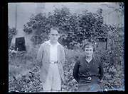 mother with son in the backyard garden France 1933