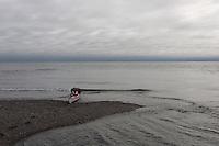 Kayak at the shore by Laxebu, Svalbard