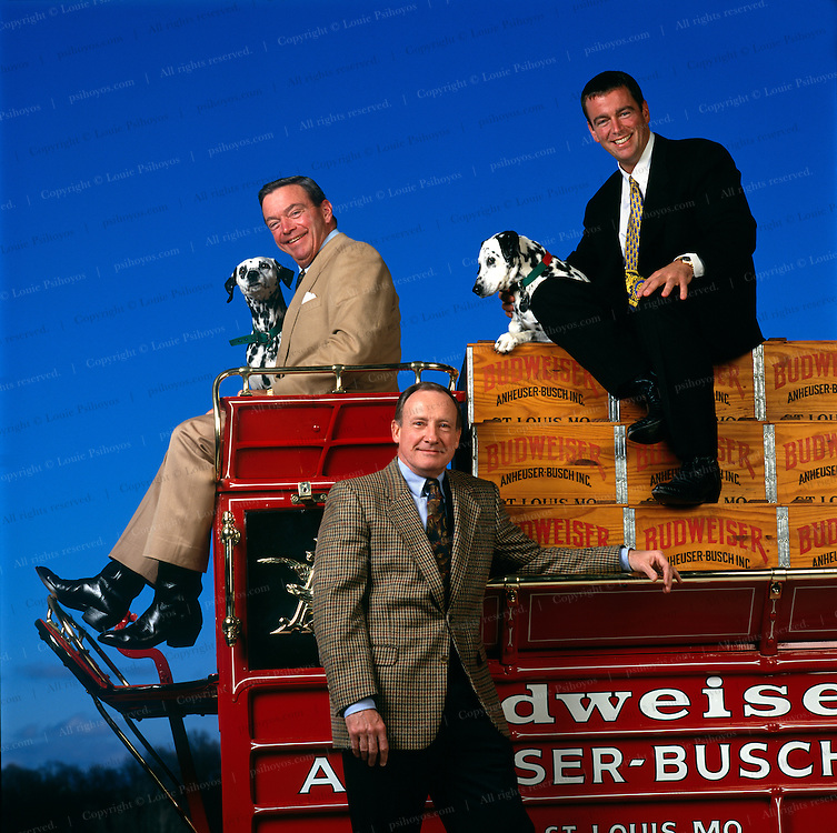 Patrick T. Stokes (standing) president and CEO of Anheuser-Busch, August A. Busch III (top left) is the Chairman of the Board and his son August A. Busch IV is president of the beer company.