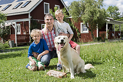 Young family father sons pet dog garden