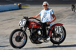 Gloria Struck on Steve Coe's flathead racer on the New Smyrna Speedway after the Sons of Speed Race during Daytona Bike Week. New Smyrna Beach, FL. USA. Saturday March 17, 2018. Photography ©2018 Michael Lichter.