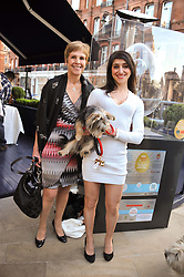 Left to right, GEORGINA ANDREWS and her daughter JESSICA ANDREWS with their dog Bertie Boo at The Dog's Trust Awards announcement held at George, 87-88 Mount Street, London on 27th March 2012.